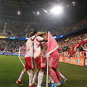 Tim Cahill, New York Red Bulls, is hugged by team mates after after his 97th minute  header leveled the scores at 2-2 during the New York Red Bulls V New England Revolution, Major League Soccer regular season match at Red Bull Arena, Harrison, New Jersey. USA. 5th October 2013. Photo Tim Clayton