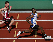 05/14/2009 - Grant's Terik Springfield (499) strides to the finish line just ahead of Franklin's Jordan Bird (441) in the men's 100 meter race. The 6A PIL Varsity District Track Meet takes place at Lewis and Clark College....KEYWORDS:  City, Portland, sports, high school, state, boys, girls