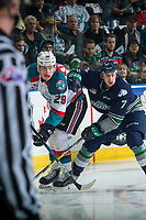 KELOWNA, CANADA - APRIL 26: Reece Harsch #7 of the Seattle Thunderbirds back checks Nolan Foote #29 of the Kelowna Rockets as he skates for the puck into the corner on April 26, 2017 at Prospera Place in Kelowna, British Columbia, Canada.  (Photo by Marissa Baecker/Shoot the Breeze)  *** Local Caption ***
