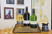 Scotch single malt whisky, Ledaig and 10-year-old Tobermory with dram glasses for dramming (tasting) at Tobermory Distillery on the Isle of Mull in Western Isles of Scotland