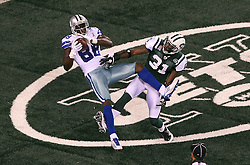 Sept 11, 2011; East Rutherford, NJ, USA;  Dallas Cowboys wide receiver Dez Bryant (88) catches a touchdown pass over New York Jets cornerback Antonio Cromartie (31) during the first half at the MetLife Stadium.