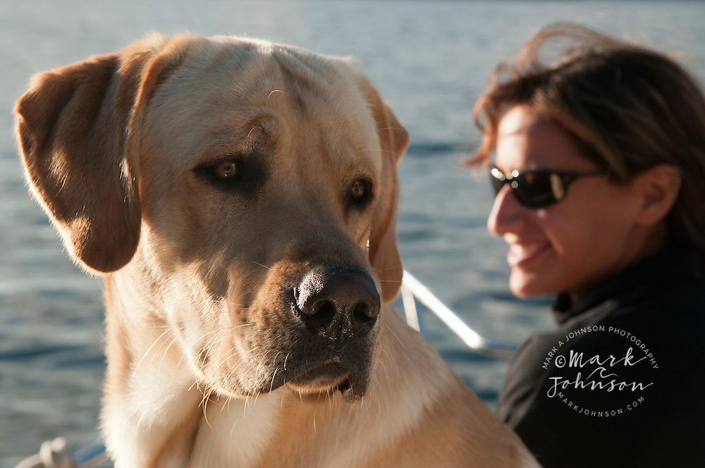 Woman and her pet dog on a boat, Sitka, Alaska