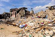 Onna  10 Aprile 2009.Terremoto Abruzzo.Macerie nelle vie del paese devastato dal terremoto.A pile of rubble  in the main street of the devastated small village ..