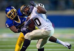 October 10, 2009; San Jose, CA, USA;  San Jose State Spartans safety Duke Ihenacho (2) tackles Idaho Vandals running back Princeton McCarty (20) during the fourth quarter at Spartan Stadium.  Idaho won 29-25.
