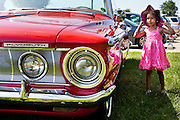 TOM McCARTHY JR. | CR STAFF<br /> Four-year-old Emma checks out a classic Plymouth Convertible during the annual St. Louis, Clarksville Picnic June 28.
