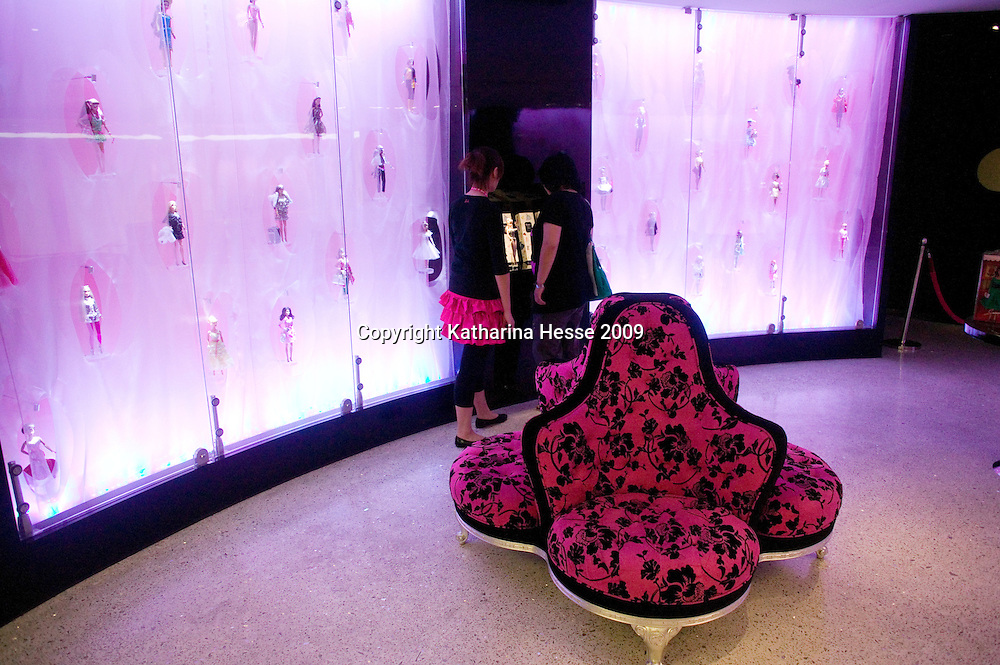 SHANGHAI, JUNE-14 : visitors look at a Barbie doll exhibition inside the newly opened Barbie store.