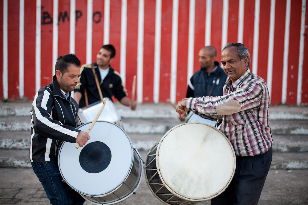 "Father Abdush (right) and his sons Mersid (2nd left), Erdal ( left) and Ergul (2nd right) during a drum session on a stage in front of the ""House of Culture"" in Delcevo, Macedonia. The Roma family - father and his 3 sons - are well know for their drum perfomances and also they build their drums themselves."