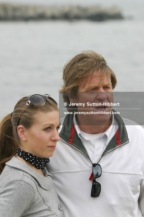 Tim Blackman ( father of murdered UK national Lucy), with daughter Sophie (in sunglasses),  pay their respects to Lucy by visiting the cave and drinking champagne in her memory on the beach where her dismembered body was found, Aburatsubo beach, near Tokyo, Japan on Monday, April 23rd 2007.  The verdict will be announced in the trial of Joji Obara for Lucy Blackman's murder (and rapes of other women) on Tuesday April 24th 2007,