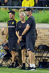SOUTH BEND, INDIANA, USA - Friday, July 19, 2019: Borussia Dortmund's head coach Lucien Favre and Liverpool's manager Jürgen Klopp embrace after a friendly match between Liverpool FC and Borussia Dortmund at the Notre Dame Stadium on day four of the club's pre-season tour of America. (Pic by David Rawcliffe/Propaganda)