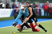 Blair Hilton of New Zealand tries to score against George Pinner of England in the shoot-outs during the bronze medal match between New Zealand and England. Glasgow 2014 Commonwealth Games. Hockey, Bronze Medal Match, Black Sticks Men v England, Glasgow Green Hockey Centre, Glasgow, Scotland. Sunday 3 August 2014. Photo: Anthony Au-Yeung / photosport.co.nz