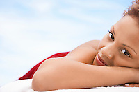 Woman lying on massage table head and shoulders close up