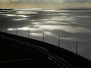 Nederland, Oostelijk Flevoland, 16-04-2012; IJsselmeerdijk, windmolens in het water van het IJsselmeer, bij ondergaande zon en in tegenlicht..IJsselmeerdijk, windmills in the water of the IJssel lake, at sunset and backlight..luchtfoto (toeslag), aerial photo (additional fee required).foto/photo Siebe Swart