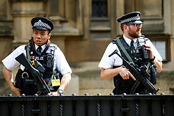 © Licensed to London News Pictures. 03/08/2016. London, UK. Armed police officers guarding Houses of Parliament in Westminster, London on 3 August 2016. More armed police will be seen on patrol in London, Metropolitan Police commissioner Sir Bernard Hogan-Howe and Mayor of London Sadiq Khan announced. Photo credit: Tolga Akmen/LNP