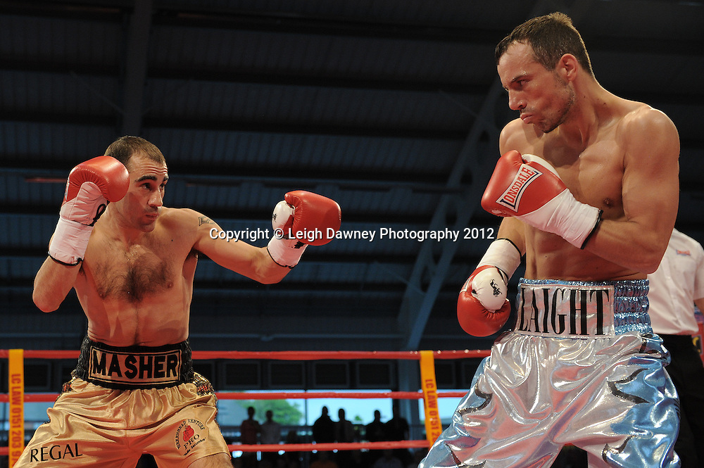 Sean Dodd defeats Kristian Laight in a 4x3 Lightweight contest at the Aintree Equestrian Centre, Liverpool on the 19th May 2012. Frank Maloney Promotions © Leigh Dawney Photography 2012.Sean Dodd (gold shorts) defeats Kristian Laight in a 4x3 Lightweight contest at the Aintree Equestrian Centre, Liverpool on the 19th May 2012. Frank Maloney Promotions © Leigh Dawney Photography 2012.