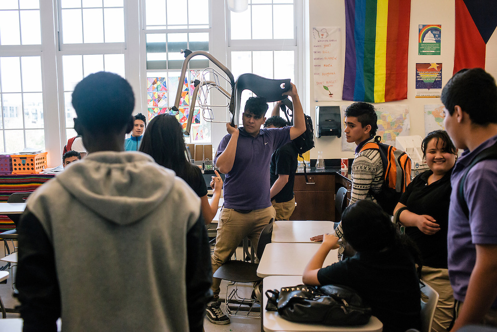 Students in Washington D.C.'s first-year International Academy for English-language learners, including Jose Rodas, 17, of El Salvador,  moves his chair back to his desk during class at the International Academy at Cardozo Education Campus on April 22, 2015. The program is aimed at dealing with the influx of unaccompanied minors, mostly from Central American countries, and allows them to be in classes of 25 together. Currently Cardozo, in NW Washington DC has about 200 of these students.
