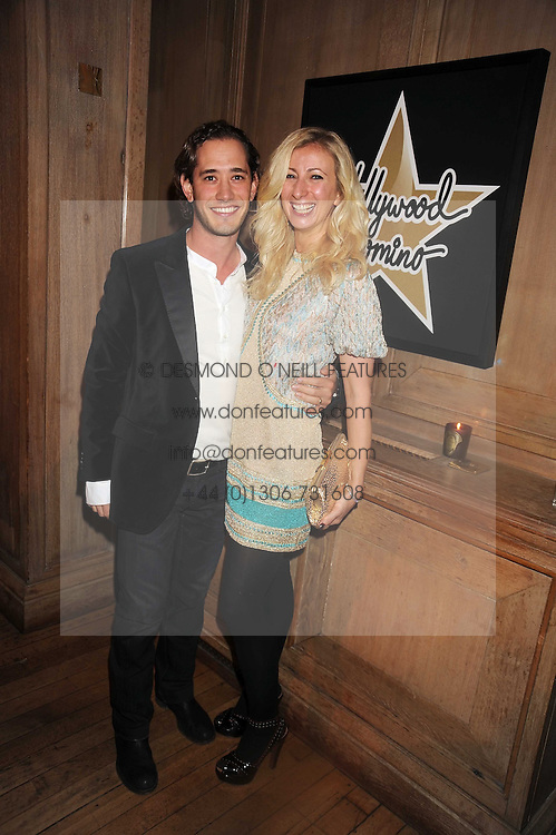 JENNY HALPERN and her husband RYAN PRINCE at a party to celebrate the launch of Hollywood Domino - a brand new board game, held at Mosimann's 11b West Halkin Street, London on 7th November 2008.  The evening was in aid of Charlize Theron's Africa Outreach Project.