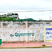 Political message painted on a whitewashed wall in Zihuatanejo, Mexico