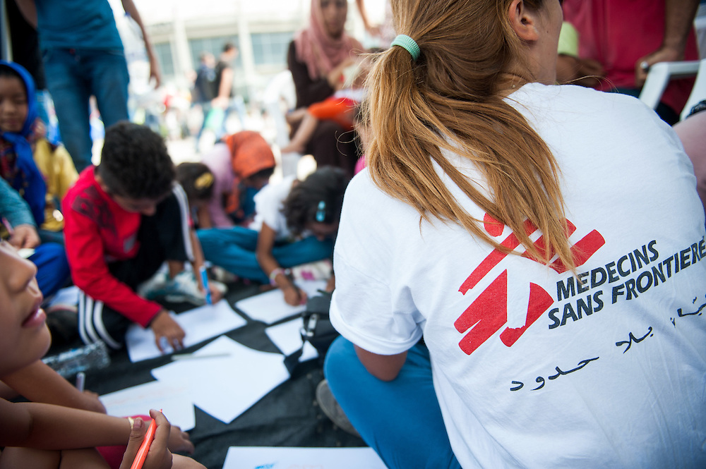 MSF psychiatrist Lena Cachou is doing a programme with Afghan kids with the help of translator Bashir Salarzai outside the mobile camper van of MSF at Mytiline port, Lesvos, Greece.
