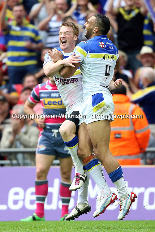 PICTURE BY VAUGHN RIDLEY/SWPIX.COM - Rugby League - Challenge Cup Final 2012 - Leeds Rhinos v Warrington Wolves - Wembley Stadium, London, England - 25/08/12 - Warrington's Ryan Atkins celebrates his try with Chris Riley.