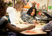 John Trejo, right, works on a writing assignment in Ms. Bergen's third grade class at Bennion Elementary School in Salt Lake City, Monday, Dec. 17, 2012.