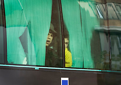 EDITORS ADVISORY - YOUTHS PICTURED MAY BE UNDER 16© Licensed to London News Pictures. 26/10/2016. London, UK. Youths looks out from a coach window as they arrive at a Home Office immigration centre in Croydon.  Hundreds of unaccompanied children are being brought over from France as the French government closes the Calais jungle camp. Photo credit: Peter Macdiarmid/LNP
