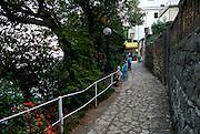 Two children (9 years old, 5 years old) on paved walkway, the Lungomare (Seaside Promenade). Opatija, Croatia
