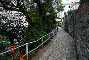 Two children (9 years old, 5 years old) on paved walkway, the Lungomare (Seaside Promenade). Opatija, Croatia