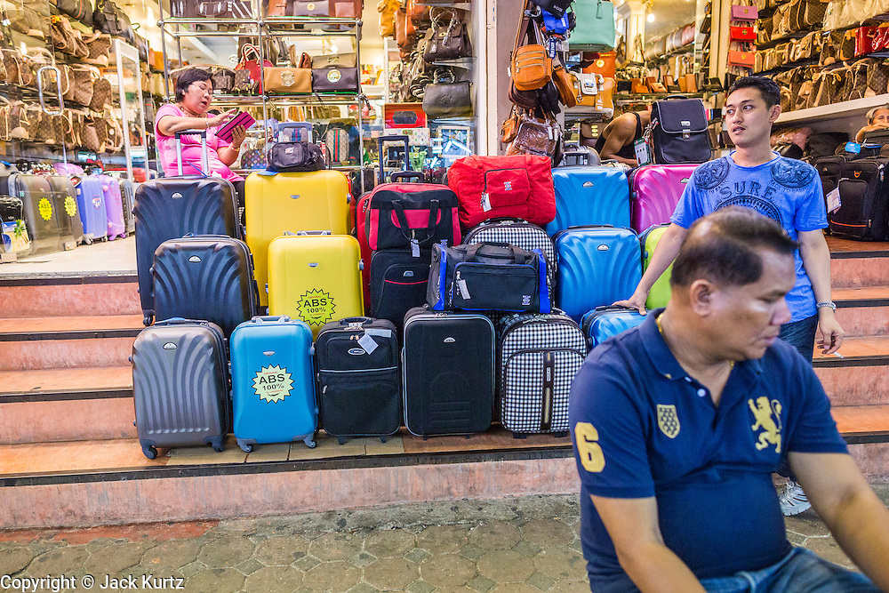 4 JUNE 2013 - BANGKOK, THAILAND:  Suitcase and bag vendors in the Patpong Night Bazaar in Bangkok. Patpong was one of Bangkok's notorious red light districts but has been made over as a night market selling clothes, watches and Thai handicrafts. The old sex oriented businesses still exist but the area is now better known for its night shopping.      PHOTO BY JACK KURTZ
