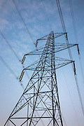 Electricity pylon and power cables close-up, a sculptural metal giant structure, in England, UK