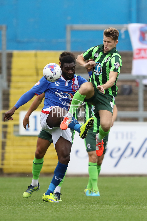 Jabo Ibehre, Jake Reeves of AFC Wimbledon during the Sky Bet League 2 match between Carlisle United and AFC Wimbledon at Brunton Park, Carlisle, England on 22 August 2015. Photo by Stuart Butcher.