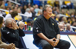 Dec 20, 2016; Morgantown, WV, USA; West Virginia Mountaineers head coach Bob Huggins smiles with West Virginia Mountaineers assistant Billy Hahn during the second half against the Radford Highlanders at WVU Coliseum. Mandatory Credit: Ben Queen-USA TODAY Sports