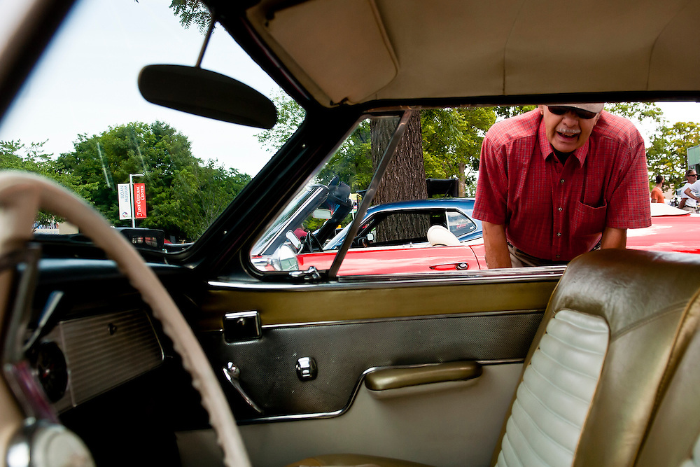 Lathan Goumas | MLive.com..Jack Kingston, of Burton, looks at a 1957 Studebaker during the 40th Sloan Museum Auto Fair at the Flint Cultural Center in Flint, Mich. on Saturday, June 23, 2012.