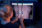 NOTE: THIS INCLUDES BOB WILLIAMS FC ONLY ON 7/13/06.Virtual Haptic Back Feature.By Christina Dierkes..Aching muscles. Shooting pains. Sore shoulders. These are symptoms doctors see in their offices everyday. Eight in ten people will visit a doctor for back pain, according to the National Institutes of Health, and the causes are many: injury, poor posture, weight problems, kidney troubles, or just working at a computer all day. .They're also some of the most difficult symptoms to treat effectively. That's not only frustrating for a doctor, but intimidating for medical students who need to learn in the classroom how to diagnose back pain woes in future patients. .The answer, say Ohio University engineers and physicians, may lie in virtual reality technology. A research team from the university's College of Osteopathic Medicine and the Russ College of Engineering and Technology has developed the Virtual Haptic Back program to offer medical students another learning tool. Using computer hardware that simulates the feel of a three-dimensional image, the project could provide physicians-in-training with a new way of learning how to diagnose and treat back problems such as pain and stiffness...A Painful Problem..Though all doctors treat patients with back pain, osteopathic physicians (D.O.s) take a different approach from conventional medical doctors. They believe in treating each patient as a whole person, rather than focusing just on the area of the body suffering the medical problem..Osteopathic Manipulative Medicine (OMM) eliminates some of the muscle and skeletal problems that generally come with illness by manipulating the spine, a technique similar to the one used by chiropractors and massage therapists. The treatment restores fluid flow to the affected area, and the increase in nutrients and removal of waste products ?supports a person's own healing capacity so they can heal more quickly,? says David Eland, D.O., professor of osteopathic manipulative medicine at Oh