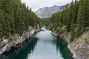 Cascade River flows into Stewart Canyon at Lake Minnewanka, in Banff National Park, Canadian Rocky Mountains, Alberta, Canada.