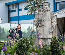 To mark it's centenary, the Commonwealth War Graves Commission has teamed up with Glen Art and the Wilfred Owen Association to create a remembrance garden at the annual Gardening Scotland event. Pictured is volunteer and forces veteran Jason Turner from Edinburgh keeping the plants well watered.<br /> <br /> © Dave Johnston/ EEm