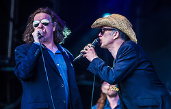 "Jake Black and Rob Spragg of Alabama 3 play the main stage. Sunday, Rockness 2013, the annual music festival which took place in Scotland at Clune Farm, Dores, on the banks of Loch Ness, near Inverness in the Scottish Highlands. The festival is known as ""the most beautiful festival in the world""."