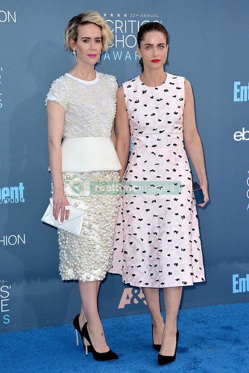 Sarah Paulson and Amanda Peet attend the 22nd Annual Critics' Choice Awards at Barker Hangar on December 11, 2016 in Santa Monica, Los Angeles, CA, USA. Photo By Lionel Hahn/ABACAPRESS.COM