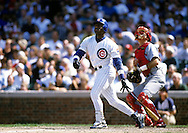 "CHICAGO, IL-SUMMER 1998:   Sammy Sosa of the Chicago Cubs connects for his 48th home run at Wrigley Field in Chicago, Illinois during the 1998 season.  Sammy Sosa and Mark McGwire were part of what has been called the ""Great Home Run Race of 1998"" between the two as they were both attempting to break the single season home run record of 61 held by Roger Maris since 1961.  (Photo by Ron Vesely)"