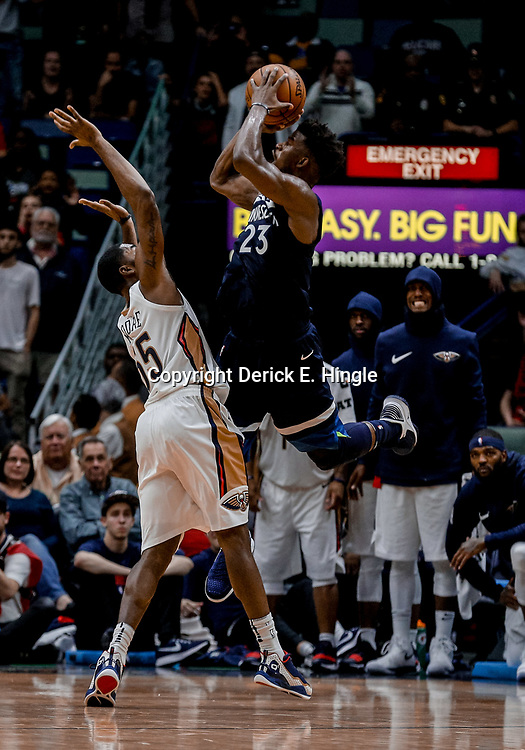 Nov 1, 2017; New Orleans, LA, USA; Minnesota Timberwolves guard Jimmy Butler (23) draws a foul on a shot and score against New Orleans Pelicans guard E'Twaun Moore (55) during the fourth quarter of a game at the Smoothie King Center. The Timberwolves defeated the Pelicans 104-98. Mandatory Credit: Derick E. Hingle-USA TODAY Sports