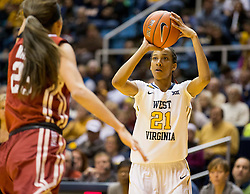 West Virginia Mountaineers guard Jessica Morton (21) shoots a three pointer against the Oklahoma Sooners during the first half at the WVU Coliseum.