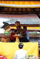 The High Priest of Puri Agung performing a ceremonial ritual in Bali, Indonesia.