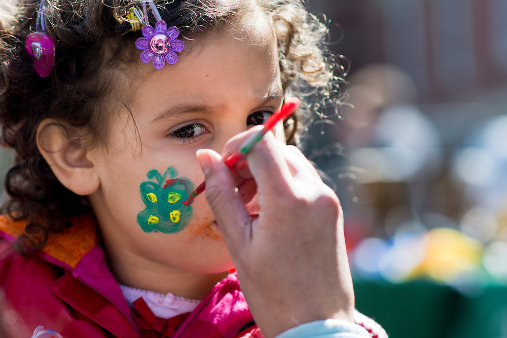 "Ariana Hueter (3) gets a butterfly painted on her face at one of the booths set up for the International Street Fair Saturday, April 20, 2013. The International Street Fair was held on Court Street from 11 a.m. to 5 p.m. during the last day of Ohio University's annual ""International Week."""