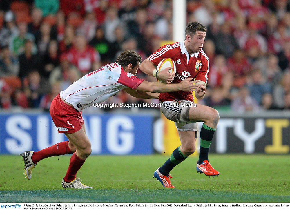 8 June 2013; Alex Cuthbert, British & Irish Lions, is tackled by Luke Morahan, Queensland Reds. British & Irish Lions Tour 2013, Queensland Reds v British & Irish Lions, Suncorp Stadium, Brisbane, Queensland, Australia. Picture credit: Stephen McCarthy / SPORTSFILE