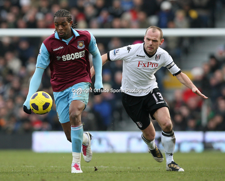 26/12/2010 - Barclays Premier League - Fulham vs. West Ham United - Danny Murphy of Fulham battles with Frederic Piquionne of West Ham - Photo: Simon Stacpoole / Offside.