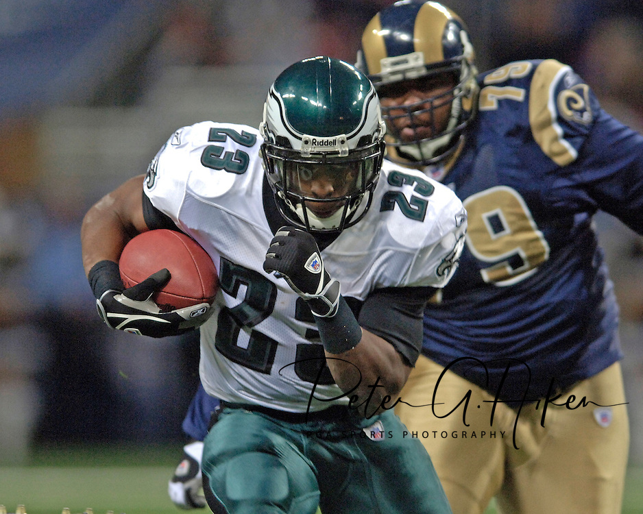 Philadelphia running back Ryan Moats (23) rushes past St. Louis Rams defensive tackle Ryan Pickett (79) for a first down in the first quarter, during the Eagles 17-16 win at the Edward Jones Dome in St. Louis, Missouri, December 18, 2005.