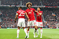 Football - 2016 / 2017 UEFA Europa League - Semi-Final, Second Leg: Manchester United [1] vs. Celta Vigo [0]<br /> <br /> Marouane Fellaini of Manchester United celebrates scoring his sides first goal with Luis Antonio Valencia and Jesse Lingard.<br /> <br /> COLORSPORT/LYNNE CAMERON