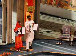 Kailash Satyarthi (R) and Malala Yousafzai present their medals during the Nobel Peace Prize awarding ceremony in Oslo, Norway, Dec. 10, 2014. Kailash Satyarthi and Malala Yousafzai, two child welfare activists from Indian and Pakistan respectively, on Wednesday received the 2014 Nobel peace prize. EXPA Pictures © 2014, PhotoCredit: EXPA/ Photoshot/ Liu Min<br /> <br /> *****ATTENTION - for AUT, SLO, CRO, SRB, BIH, MAZ only*****