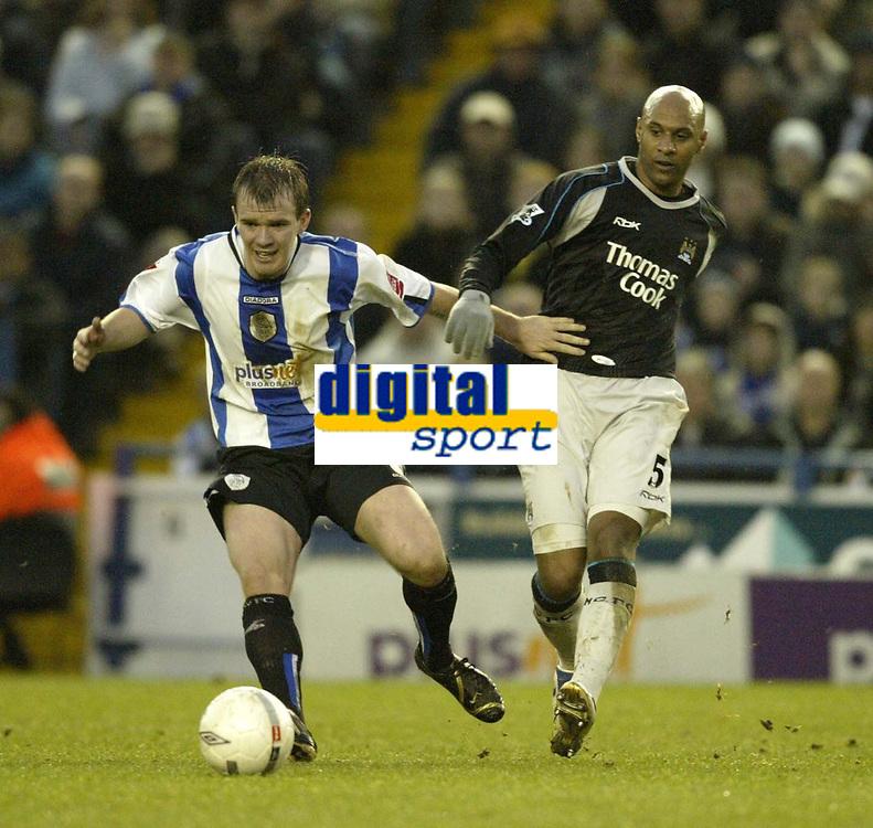Photo: Aidan Ellis.<br /> Sheffield Wednesday v Manchester City. The FA Cup. 07/01/2007.<br /> Wednesday's Glenn Whelan (L) battles with City's Ousmane Dabo