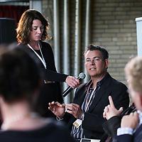 Nederland, Achlum , 28 mei 2011..Conventie van Achlum..Achmea bestaat dit jaar 200 jaar. In dit jubileumjaar gaat Achmea terug naar haar roots: het Friese dorpje Achlum. Op 28 mei vindt daar de Conventie van Achlum plaats. Zo'n 2000 mensen gaan daar met elkaar in gesprek over de toekomst van Nederland binnen de thema's: veiligheid, mobiliteit, arbeidsparticipatie, pensioen en gezondheid. Dit doen we met top sprekers uit de politiek en wetenschap maar ook met mensen zoals jij..Op de foto columnist Bas Heijne (r) en opiniepijler Hans anker.Foto:Jean-Pierre Jans