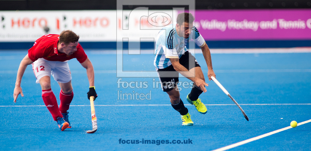 Michael Hoare of England and Manuel Brunet of Argentina battle for the ball on day four of the Men's Hero Hockey World League Semi-Finals at Lee Valley Hockey Centre, Stratford<br /> Picture by Hannah Fountain/Focus Images Ltd 07814482222<br /> 18/06/2017